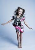Girl jumping of joy. Little girl jumping of joy Stock Image