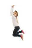 Girl jumping with joy Royalty Free Stock Image