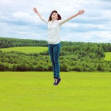 Girl jumping on a meadow Royalty Free Stock Images