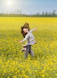 Girl jumping on meadow Stock Photo