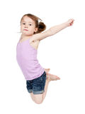 Girl jumping in midair. Cute young girl with outstretched arms jumping in midair; white studio background Stock Image