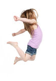 Girl jumping in midair. Side view of cute barefoot young girl in shorts jumping midair; white studio background stock images