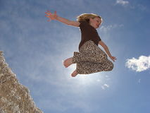 Girl Jumping off Cotten Seed Pile Royalty Free Stock Photography