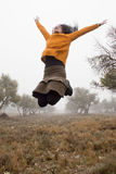 Girl jumping between olive trees. Spain Stock Photography