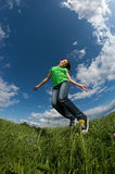 Girl jumping outdoor Royalty Free Stock Images