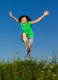 Girl jumping outdoor Stock Photos