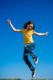 Girl jumping outdoor Stock Photos