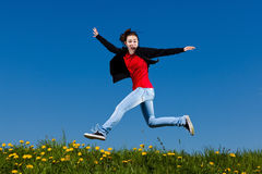 Girl jumping outdoor Stock Images