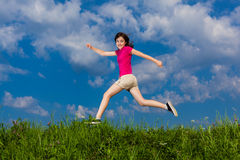 Girl jumping outdoor Stock Image