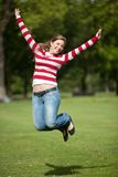 Girl jumping outdoors Stock Images