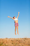 Girl jumping outdoors Royalty Free Stock Images