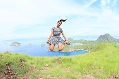 Girl jumping on Padar Island Royalty Free Stock Photography