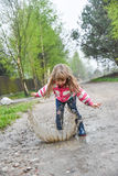 Girl jumping in a paddle stock photography
