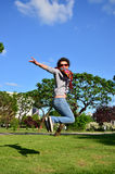 Girl jumping. A picture of a girl jumping in park Stock Photography