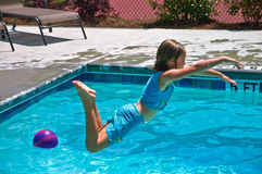 Girl Jumping into a Pool royalty free stock photos