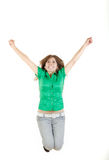 Girl jumping  with raised arms up of joy excited isolated on whi Stock Photo