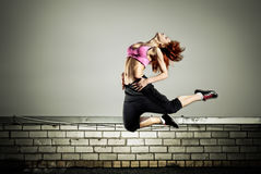 Girl jumping on the roof Stock Image