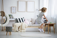 Girl jumping in room royalty free stock photos