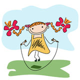 Girl jumping rope. Beautiful happy little girl playing with skipping rope outdoor Royalty Free Stock Photo