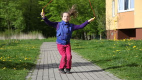 Girl jumping rope stock footage