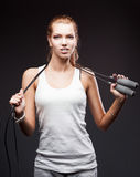 Girl with jumping-rope on dark background Royalty Free Stock Photo