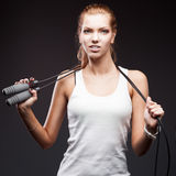 Girl with jumping-rope on dark background Stock Image