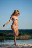 Girl jumping rope Stock Images