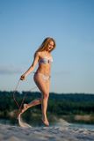Girl jumping rope Stock Image