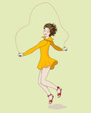 Girl jumping rope. Girl  in yellow dress   is jumping rope Stock Image