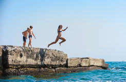 The girl jumping in the sea Stock Image