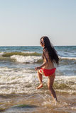 Girl jumping in sea Royalty Free Stock Photo