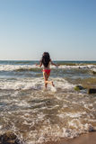 Girl jumping in sea Royalty Free Stock Image
