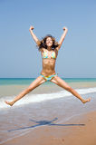 Girl jumping on seashore Stock Image
