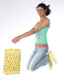 Girl jumping with shopping bags Royalty Free Stock Photo