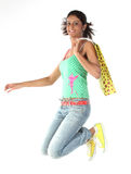 Girl jumping with shopping bags Stock Photography