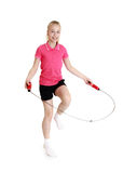 Girl jumping skipping rope Stock Photography