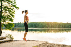 Girl jumping skipping rope on the lake Royalty Free Stock Photos