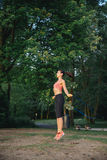 Girl jumping skipping rope on the lake Royalty Free Stock Photo