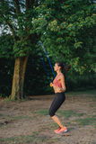 Girl jumping skipping rope on the lake Stock Photos