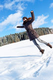 Girl jumping on snow Royalty Free Stock Photo