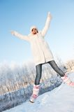 Girl jumping in the snow Stock Photos