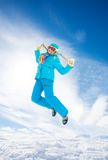 Girl jumping in snow Royalty Free Stock Images