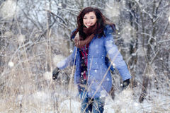 Girl  jumping in the snow Royalty Free Stock Images
