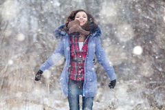 Girl  jumping in the snow Royalty Free Stock Photo