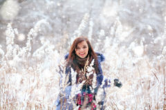 Girl  jumping in the snow Royalty Free Stock Photography