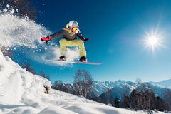 Girl is jumping with snowboard. From the hill stock image