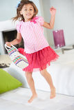 Girl Jumping On Sofa. Smiling TO Camera royalty free stock photo