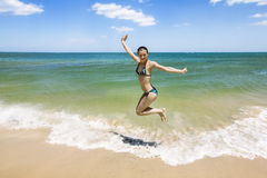 Girl jumping and splashing in the waves of the sea Royalty Free Stock Photo