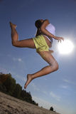 Girl jumping on summer beach Royalty Free Stock Images