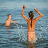 Girl jumping in the  summer sea Royalty Free Stock Photo